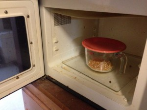 Put popcorn in microwave and microwave from 3-4 minutes depending on your microwave.